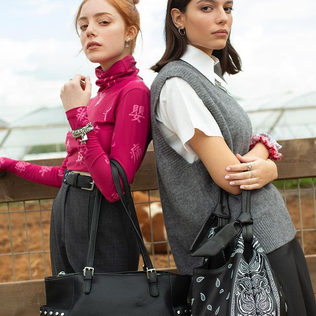 Photo shared by TopTen Accessories on February 14, 2021 tagging @topten_fashion, and @iconzbymedio. May be an image of 2 people, people standing and purse.